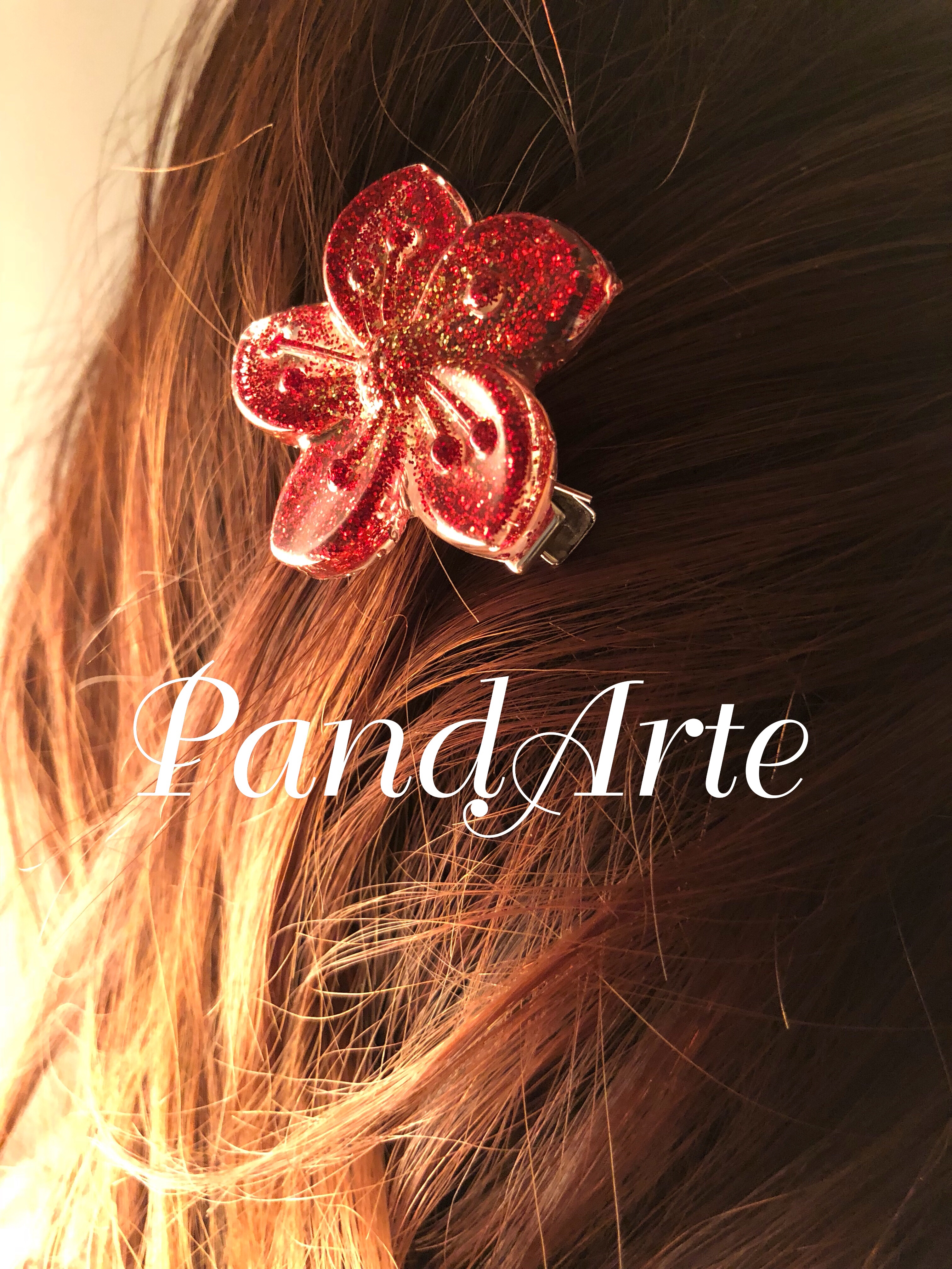 Fermacapelli con fiore rosso